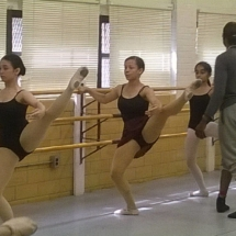 summer campers practicing at the ballet bar