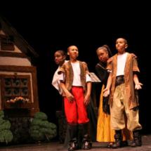 Boy acting as Gaston
