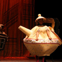 Children's theater acting as teapot in Beauty and the Beast