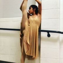 Teen New Hope Company Dancer stretching at Showcase of Movement