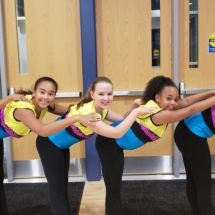 Junior dance company members pose at midnight madness